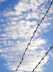 clouds_barbed_wire